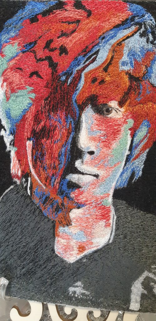 Abstract thread painting portrait by Deb Dunlop