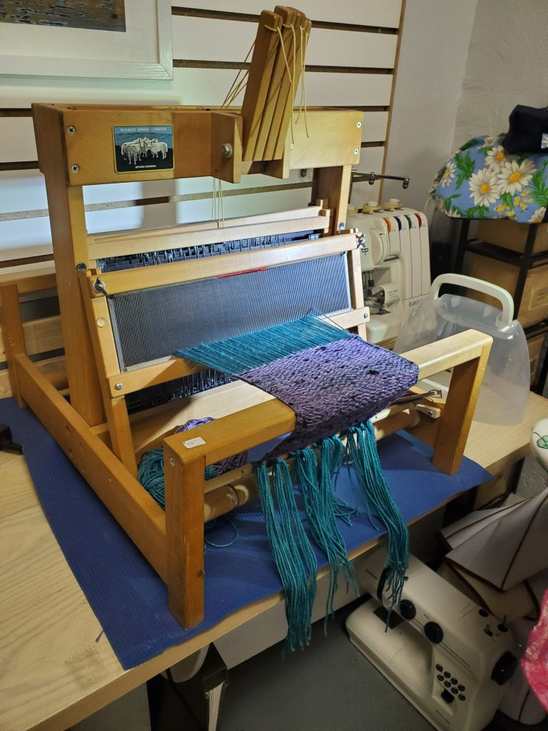Deb's latest project, a 7 foot scarf, in the process of being created on her 4-shaft loom. Deb Dunlop