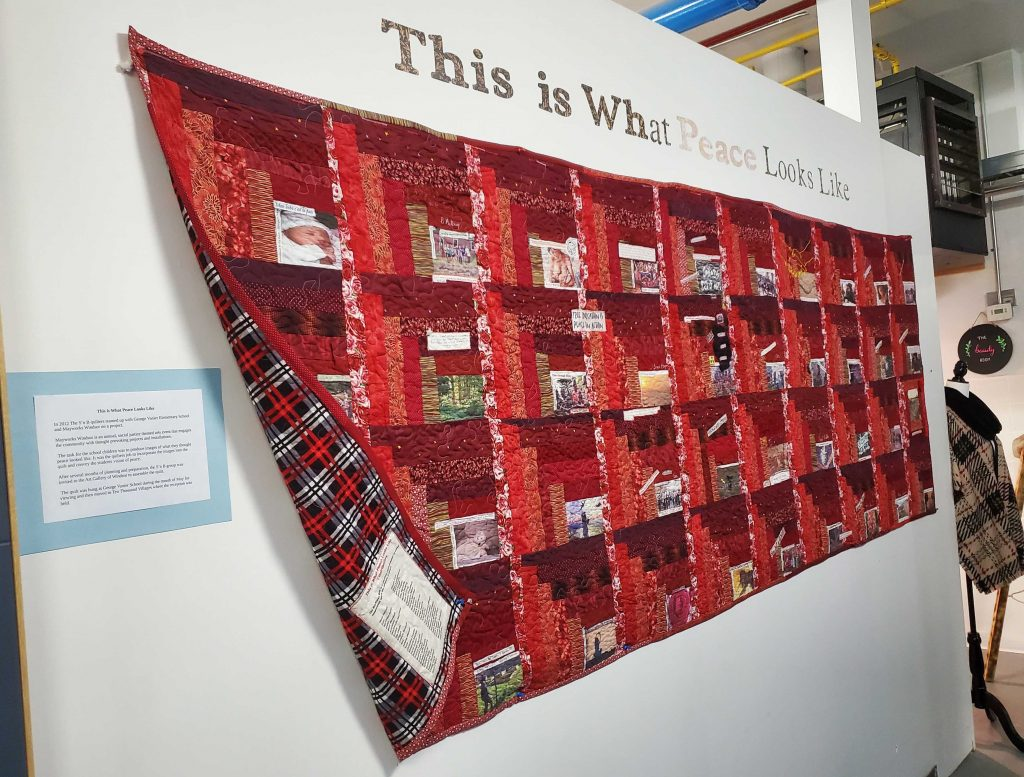 Collaborative quilt created by Deborah Dunlop in collaboration with 20 different quilters under the auspices of the Stitch 'n Bitch group and  École élémentaire catholique Georges-P.-Vanier . Hanging at Sho Studios
